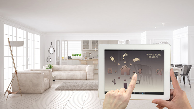 Canva - Smart remote home control system on a digital tablet. Device with app icons. Interior of scandinavian white living room and kitchen in the background, architecture design